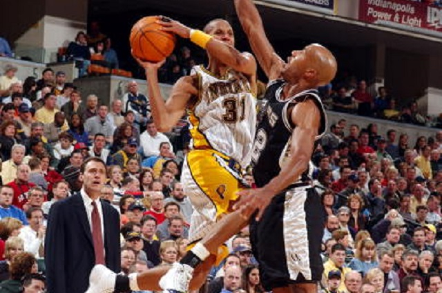 INDIANAPOLIS - MARCH 23:  Reggie Miller #31 of the Indiana Pacers battles Bruce Bowen #12 of the San Antonio Spurs on March 23, 2005 at Conseco Fieldhouse in Indianapolis, Indiana .  The Pacers defeated the Spurs 100-93.  (Photo by Ron Hoskins/NBAE via Getty Images)