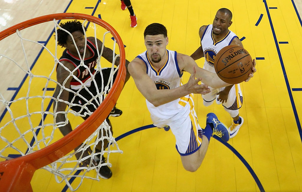 OAKLAND, CA - MAY 03:  Klay Thompson #11 of the Golden State Warriors goes up for a shot against Ed Davis #17 of the Portland Trail Blazers during Game Two of the Western Conference Semifinals during the 2016 NBA Playoffs on May 3, 2016 at Oracle Arena in Oakland, California. (Photo by Ezra Shaw/Getty Images)