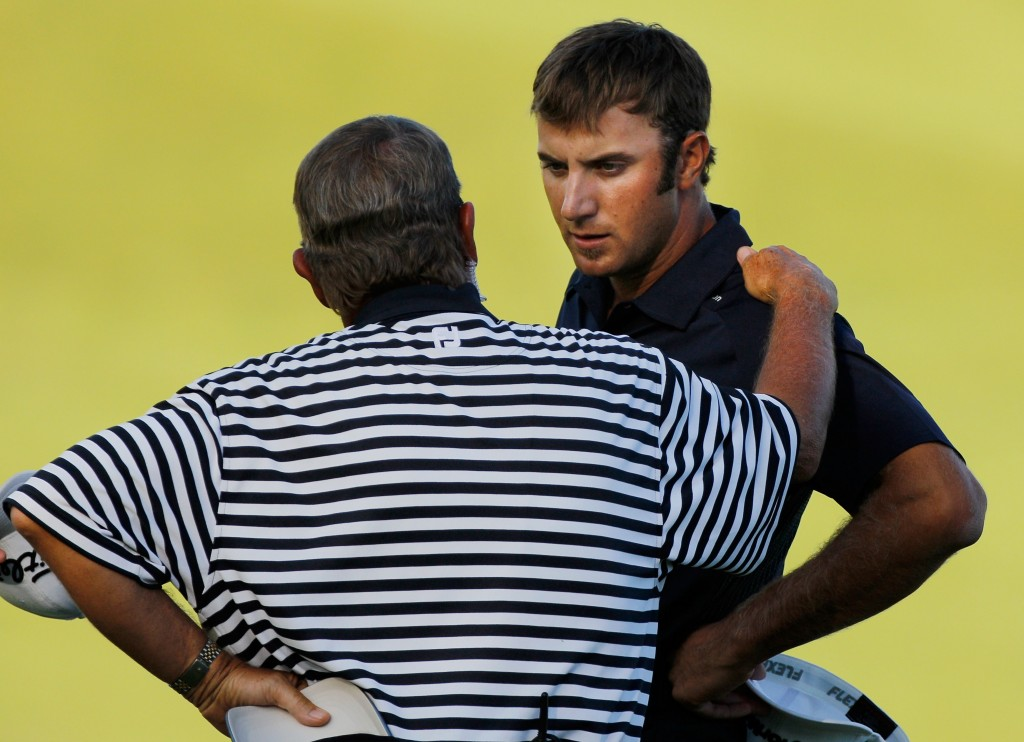 KOHLER, WI - AUGUST 15:  A PGA of America rules official chats with Dustin Johnson (R) on the 18th green during the final round of the 92nd PGA Championship on the Straits Course at Whistling Straits on August 15, 2010 in Kohler, Wisconsin.  (Photo by Sam Greenwood/Getty Images)