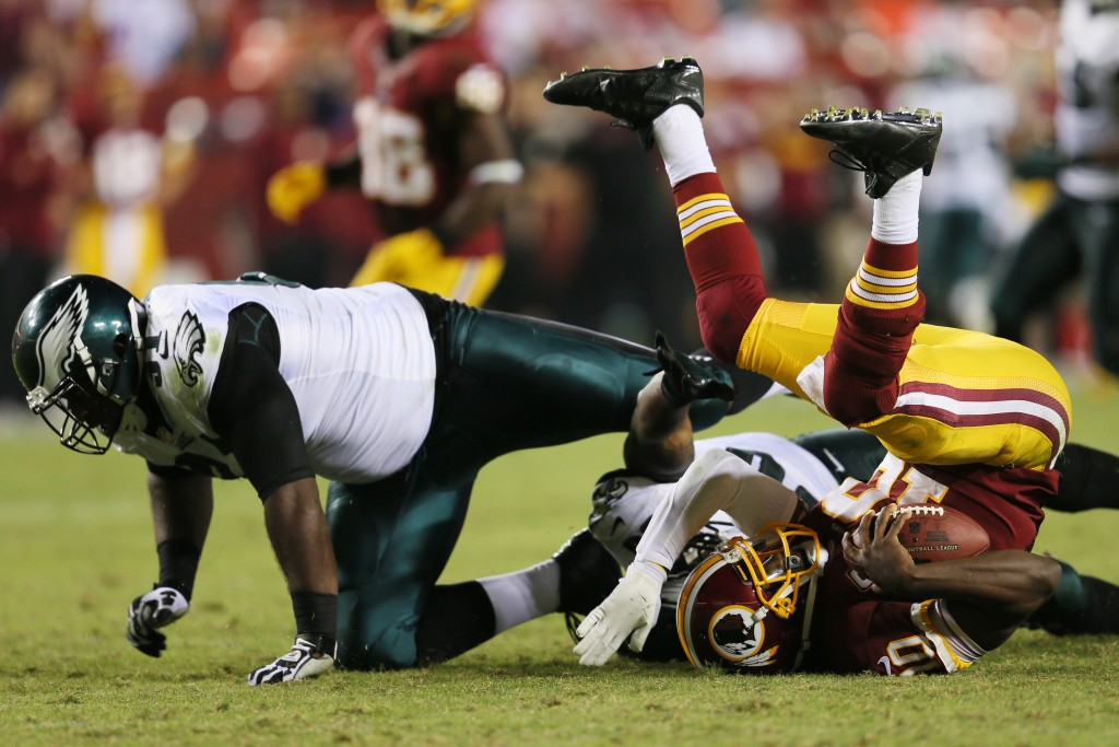 LANDOVER, MD - SEPTEMBER 09: Quarterback Robert Griffin III #10 of the Washington Redskins is sacked by defensive tackle Fletcher Cox #91 of the Philadelphia Eagles during the fourth quarter of the Eagles 33-27 win at FedExField on September 9, 2013 in Landover, Maryland.  (Photo by Rob Carr/Getty Images)