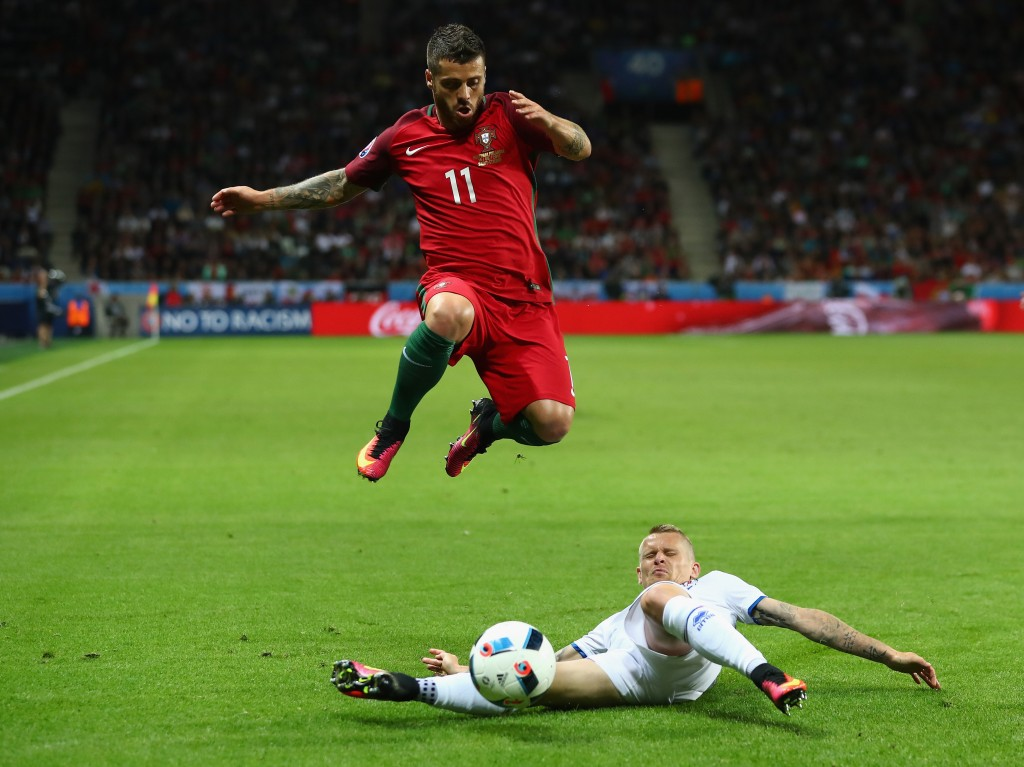 SAINT-ETIENNE, FRANCE - JUNE 14:  Vieirinha of Portugal is tackled by Ari Skulason of Iceland during the UEFA EURO 2016 Group F match between Portugal and Iceland at Stade Geoffroy-Guichard on June 14, 2016 in Saint-Etienne, France.  (Photo by Julian Finney/Getty Images)