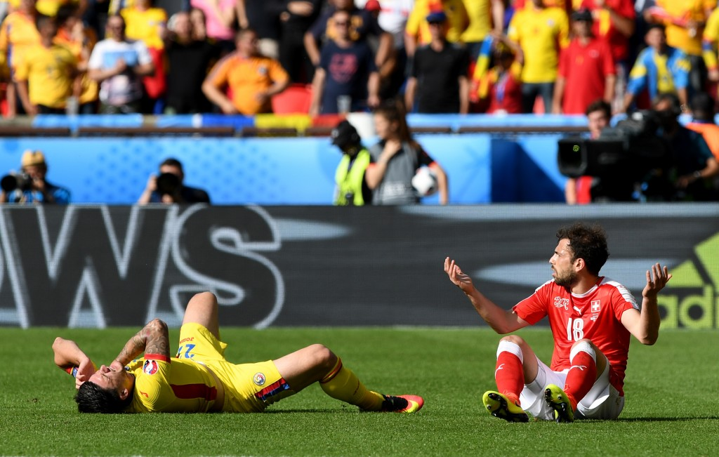 PARIS, FRANCE - JUNE 15: Admir Mehmedi of Switzerland reacts after commiting a foul on Cristian Sapunaru of Romania  during the UEFA EURO 2016 Group A match between Romania and Switzerland at Parc des Princes on June 15, 2016 in Paris, France.  (Photo by Shaun Botterill/Getty Images)