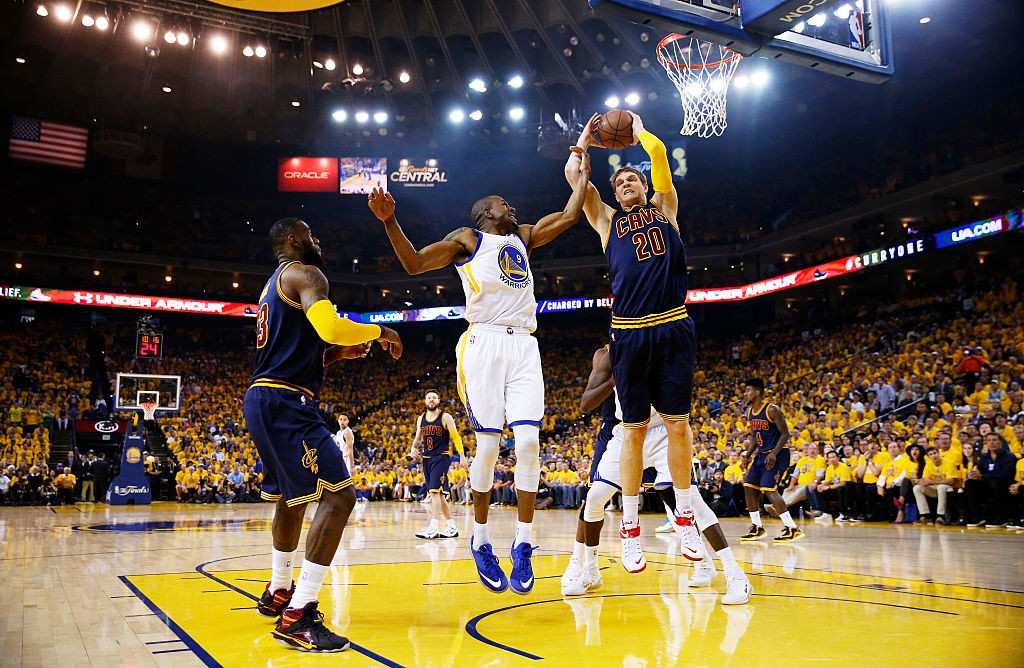 OAKLAND, CA - JUNE 14:  Andre Iguodala #9 of the Golden State Warriors and Timofey Mozgov #20 of the Cleveland Cavaliers vie for a rebound in the first quarter during Game Five of the 2015 NBA Finals at ORACLE Arena on June 14, 2015 in Oakland, California.   (Photo by Ezra Shaw/Getty Images)