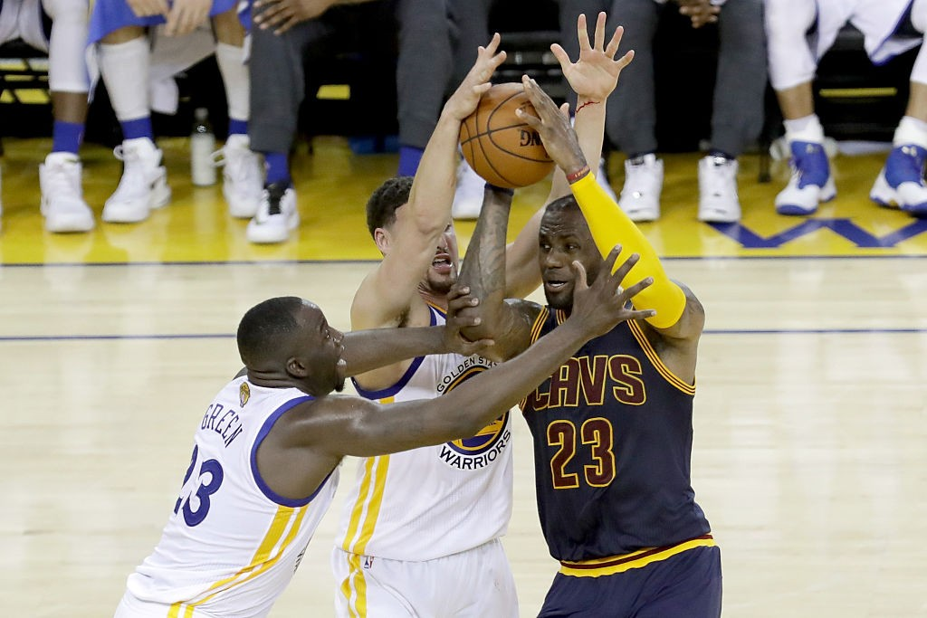 OAKLAND, CA - JUNE 05:  LeBron James #23 of the Cleveland Cavaliers with the ball against Draymond Green #23 and Klay Thompson #11 of the Golden State Warriors in the second half in Game 2 of the 2016 NBA Finals at ORACLE Arena on June 5, 2016 in Oakland, California. (Photo by Ronald Martinez/Getty Images)