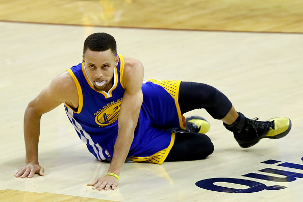 CLEVELAND, OH - JUNE 16:  Stephen Curry #30 of the Golden State Warriors lays the on the court in the second half while taking on the Cleveland Cavaliers in Game 6 of the 2016 NBA Finals at Quicken Loans Arena on June 16, 2016 in Cleveland, Ohio. (Photo by Ezra Shaw/Getty Images)