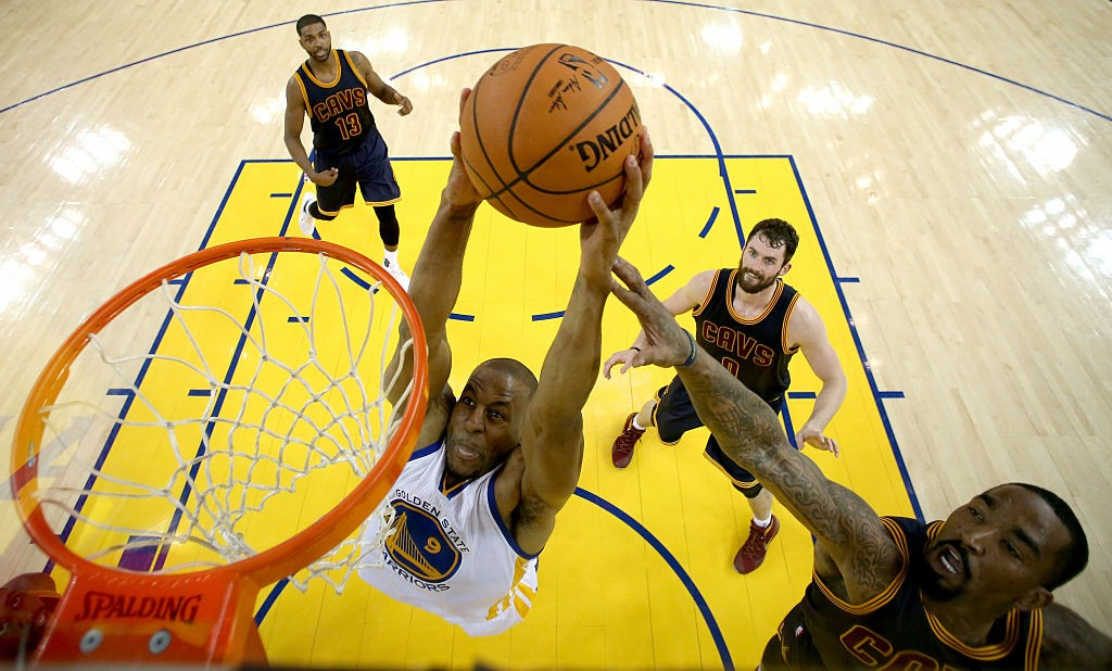 OAKLAND, CA - JUNE 02:  Andre Iguodala #9 of the Golden State Warriors goes up to dunk the ball against J.R. Smith #5 of the Cleveland Cavaliers in the first half in Game 1 of the 2016 NBA Finals at ORACLE Arena on June 2, 2016 in Oakland, California.  (Photo by Ezra Shaw/Getty Images)