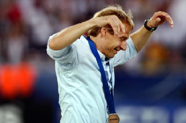 Stuttgart, GERMANY:  German head coach Juergen Klinsmann celebrates after the World Cup third-place play-off football match between Germany and Portugal. Germany won 3-1.  (Photo: STF/AFP/Getty Images)