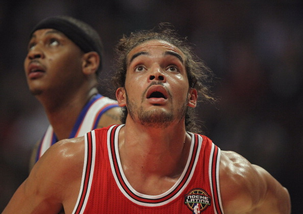 CHICAGO, IL - MARCH 12:  Joakim Noah #13 of the Chicago Bulls waits for the ball on a free-throw in front of Camelo Anthony #7 of the New York Knicks at the United Center on March 12, 2012 in Chicago, Illinois. The Bulls defeated the Knicks 104-99. (Photo by Jonathan Daniel/Getty Images)