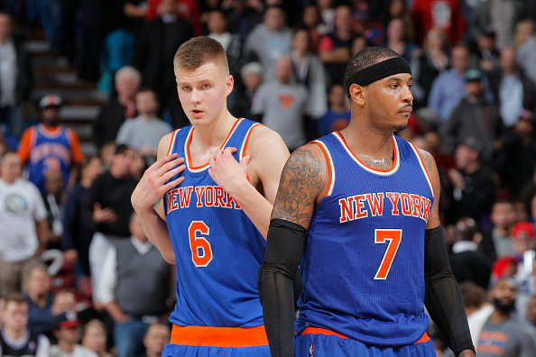 SACRAMENTO, CA - DECEMBER 10: Kristaps Porzingis #6 and Carmelo Anthony #7 of the New York Knicks look on during the game against the Sacramento Kings on December 10, 2015 at Sleep Train Arena in Sacramento, California. (Photo by Rocky Widner/NBAE via Getty Images)