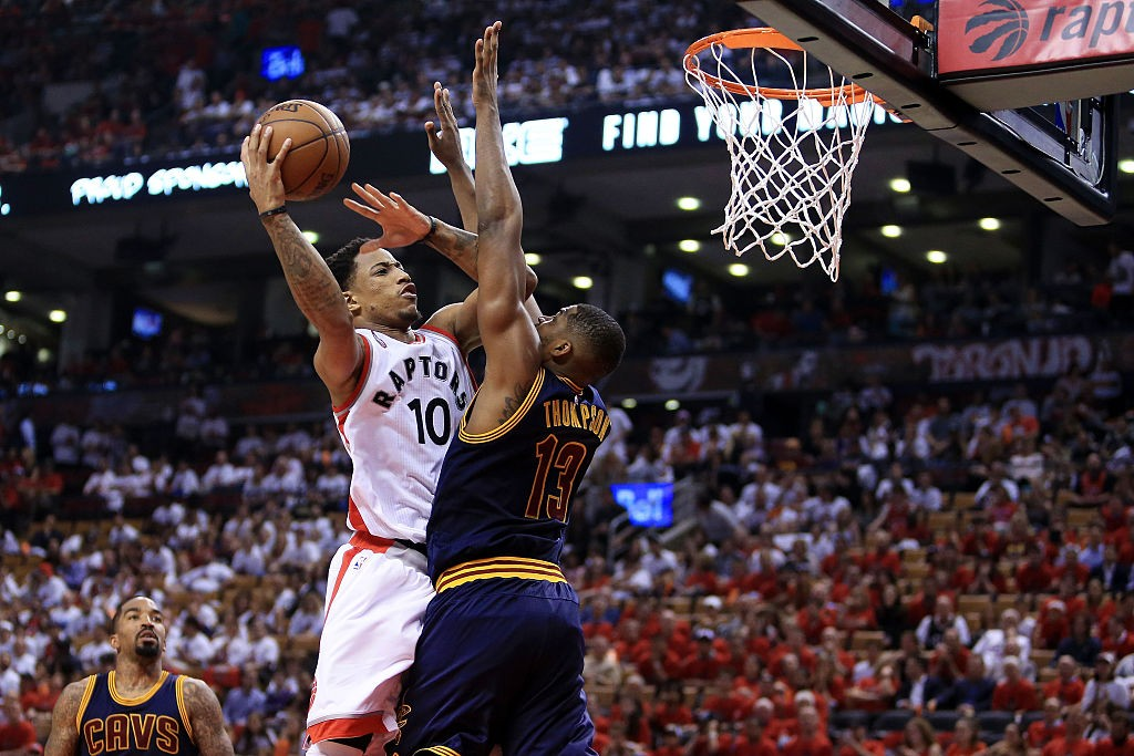TORONTO, ON - MAY 27: DeMar DeRozan #10 of the Toronto Raptors shoots against Tristan Thompson #13 of the Cleveland Cavaliers in the third quarter in game six of the Eastern Conference Finals during the 2016 NBA Playoffs at Air Canada Centre on May 27, 2016 in Toronto, Canada. (Photo by Vaughn Ridley/Getty Images)