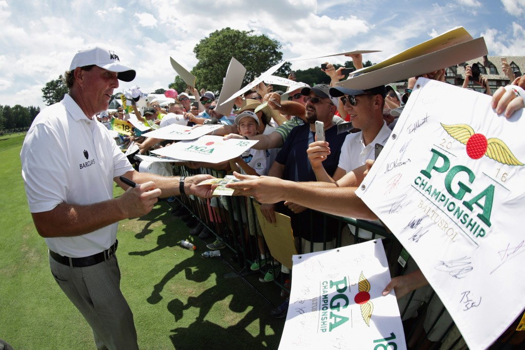 SPRINGFIELD, NJ - JULY 26:  Phil Mickelson of the United States signs his autograph for fans during a practice round prior to the 2016 PGA Championship at Baltusrol Golf Club on July 26, 2016 in Springfield, New Jersey.  (Photo by Streeter Lecka/Getty Images)