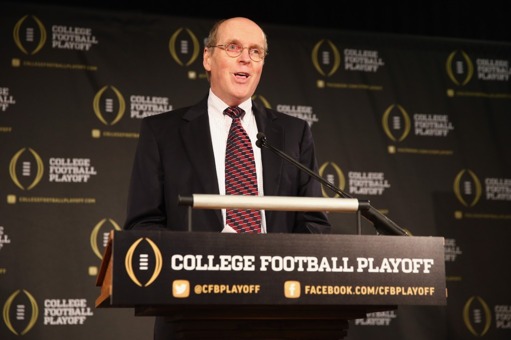 IRVING, TX - OCTOBER 16:  Bill Hancock, executive director of the College Football Playoff, announces the members of the College Football Playoff selection committee on October 16, 2013 in Irving, Texas. Condoleezza Rice, Stanford University professor and former United States Secretary of State, was chosen to serve as one of the 13 members that will select four teams to compete in the first playoff at the end of the 2014 season.  (Photo by Tom Pennington/Getty Images)