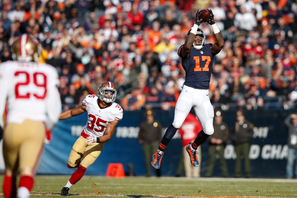 CHICAGO, IL - DECEMBER 06:   Alshon Jeffery #17 of the Chicago Bears catches a 31 yard pass in front of  Eric Reid #35 of the San Francisco 49ers in the first quarter at Soldier Field on December 6, 2015 in Chicago, Illinois.  (Photo by Joe Robbins/Getty Images)