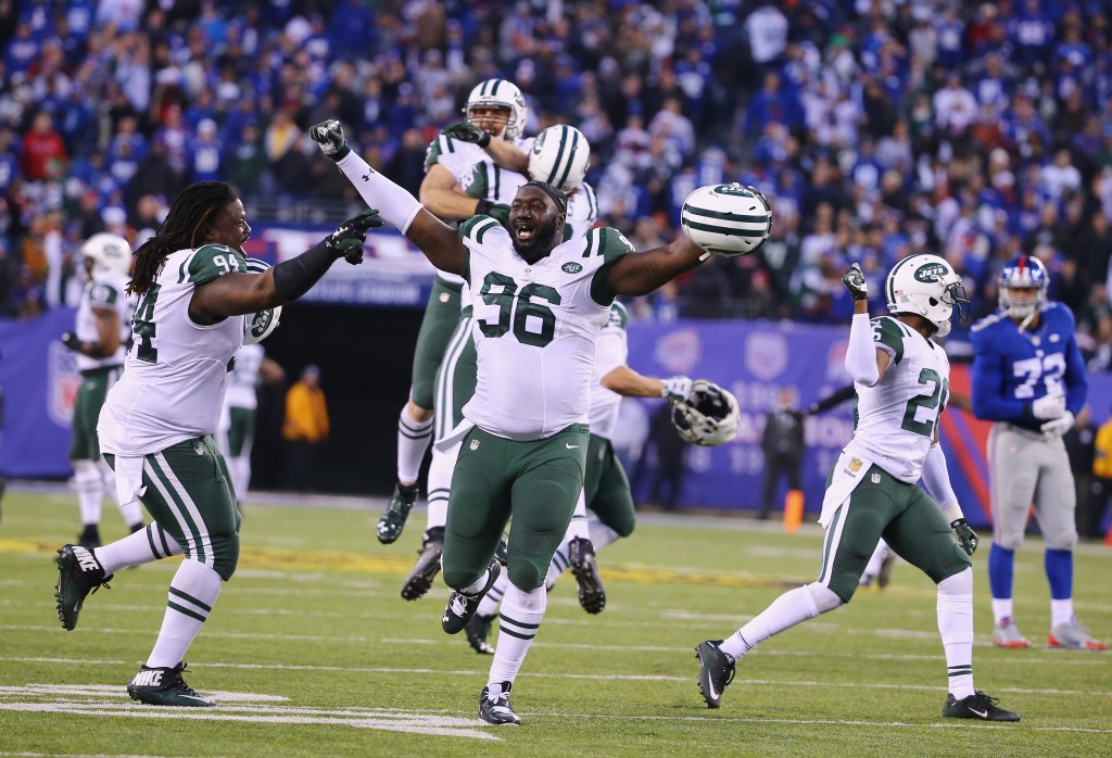 EAST RUTHERFORD, NJ - DECEMBER 06:  Muhammad Wilkerson #96 and  Damon Harrison #94 of the New York Jets celebrate their 23-20 overtime win against theNew York Giants  during their game at MetLife Stadium on December 6, 2015 in East Rutherford, New Jersey.  (Photo by Al Bello/Getty Images)