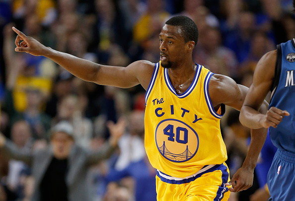 OAKLAND, CA - APRIL 05:  Harrison Barnes #40 of the Golden State Warriors reacts after he made a three-point basket against the Minnesota Timberwolves at ORACLE Arena on April 5, 2016 in Oakland, California. (Photo by Ezra Shaw/Getty Images)