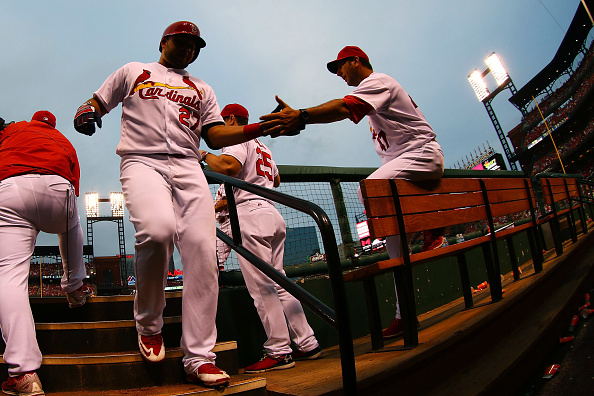 ST. LOUIS, MO - JUNE 30: Jhonny Peralta #27 of the St. Louis Cardinals is congratulated by John Mabry #47 of the St. Louis Cardinals after hitting a solo home run against the Kansas City Royals in the sixth inning at Busch Stadium on June 30, 2016 in St. Louis, Missouri.  (Photo by Dilip Vishwanat/Getty Images)