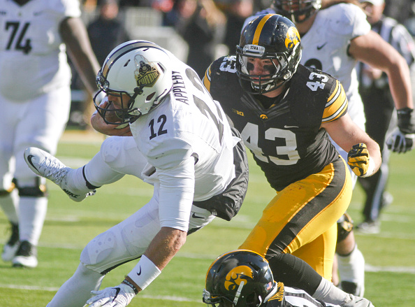 IOWA CITY, IA - NOVEMBER 21:  Quarterback Austin Appleby #12 of the Purdue Boilermakers is brought down in the second half by linebacker Josey Jewell #43 and defensive back Joshua Jackson #15 of the Iowa Hawkeyes on November 21, 2015 at Kinnick Stadium, in Iowa City, Iowa.  (Photo by Matthew Holst/Getty Images)