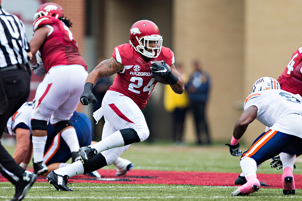 FAYETTEVILLE, AR - OCTOBER 31:  Kody Walker #24 of the Arkansas Razorbacks runs the ball during a game against the UT Martin Skyhawks at Razorback Stadium on October 31, 2015 in Fayetteville, Arkansas.  The Razorbacks defeated the Skyhawks 63-28.  (Photo by Wesley Hitt/Getty Images)