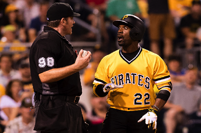 PITTSBURGH, PA - JUNE 26: Andrew McCutchen #22 of the Pittsburgh Pirates argues with umpire Chris Conroy #98 after being called out on strikes in the seventh inning during the game against the Los Angeles Dodgers at PNC Park on June 26, 2016 in Pittsburgh, Pennsylvania. (Photo by Justin Berl/Getty Images)