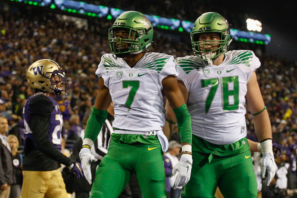 SEATTLE, WA - OCTOBER 17:  Wide receiver Darren Carrington #7 of the Oregon Ducks is congratulated by Cameron Hunt #78 after scoring a touchdown in the first quarter against the Washington Huskies on October 17, 2015 at Husky Stadium in Seattle, Washington.  (Photo by Otto Greule Jr/Getty Images)