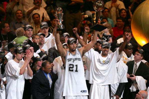 UNITED STATES - JUNE 23:  Basketball: NBA Finals, San Antonio Spurs Tim Duncan (21) victorious with MVP and Championship trophy after winning game vs Detroit Pistons, Game 7, San Antonio, TX 6/23/2005  (Photo by John W. McDonough/Sports Illustrated/Getty Images)  (SetNumber: X73797 TK1)