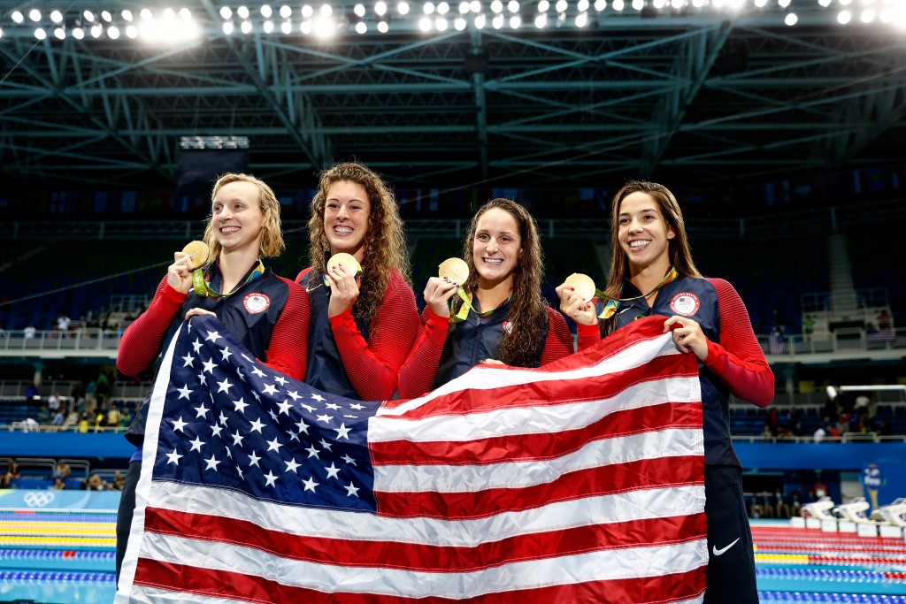 RIO DE JANEIRO, BRAZIL - AUGUST 10:  Gold medalists Allison Schmitt, Leah Smith, Maya Dirado and Katie Ledecky of the United States pose on the podium during the medal ceremony for the Women's 4 x 200m Freestyle Relay Final on Day 5 of the Rio 2016 Olympic Games at the Olympic Aquatics Stadium on August 10, 2016 in Rio de Janeiro, Brazil.  (Photo by Clive Rose/Getty Images)