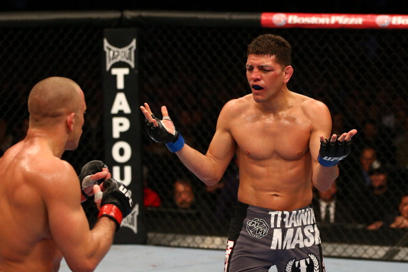 MONTREAL, QC - MARCH 16:  (R-L) Nick Diaz taunts Georges St-Pierre in their welterweight championship bout during the UFC 158 event at Bell Centre on March 16, 2013 in Montreal, Quebec, Canada.  (Photo by Jonathan Ferrey/Zuffa LLC/Zuffa LLC via Getty Images)