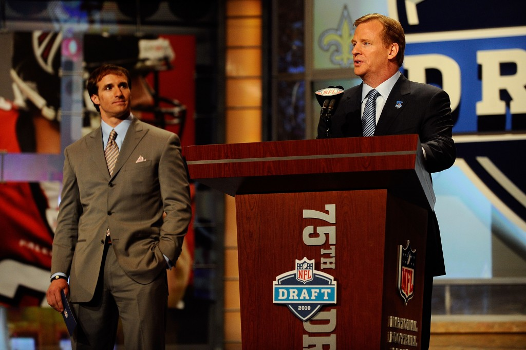 NEW YORK - APRIL 22:  NFL Commissioner Roger Goodell (R) introduces Drew Brees of the New Orleans Saints during the first round of the 2010 NFL Draft at Radio City Music Hall on April 22, 2010 in New York City. Brees then announced that the Saints had selected Patrick Robinson from Florida State with the last pick of the first round (number 32 overall). (Photo by Jeff Zelevansky/Getty Images)