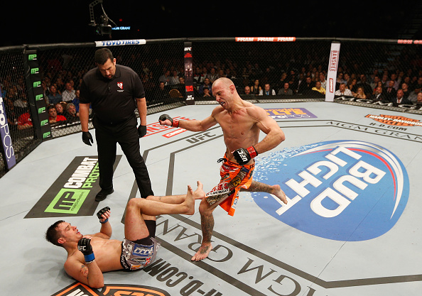 LAS VEGAS, NV - JANUARY 03:  (R-L) Donald Cerrone kicks Myles Jury in their lightweight bout during the UFC 182 event on at the MGM Grand Garden Arena January 3, 2015 in Las Vegas, Nevada.  (Photo by Josh Hedges/Zuffa LLC/Zuffa LLC via Getty Images)