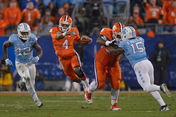 CHARLOTTE, NC - DECEMBER 05:  Deshaun Watson #4 of the Clemson Tigers runs against the North Carolina Tar Heels during the Atlantic Coast Conference Football Championship at Bank of America Stadium on December 5, 2015 in Charlotte, North Carolina. Clemson won 45-37.  (Photo by Grant Halverson/Getty Images)