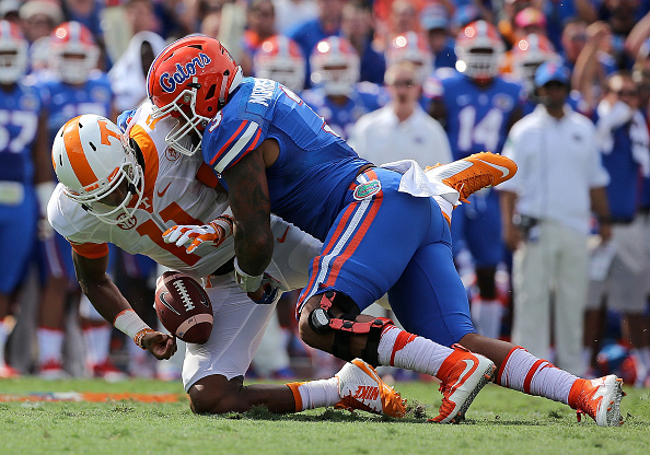 GAINESVILLE, FL - SEPTEMBER 26: Joshua Dobbs #11 of the Tennessee Volunteers is sacked by Treon Harris #3 of the Florida Gators during a game  at Ben Hill Griffin Stadium on September 26, 2015 in Gainesville, Florida.  (Photo by Mike Ehrmann/Getty Images)