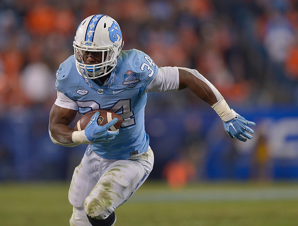 CHARLOTTE, NC - DECEMBER 05:  Elijah Hood #34 of the North Carolina Tar Heels runs against the Clemson Tigers during the Atlantic Coast Conference Football Championship at Bank of America Stadium on December 5, 2015 in Charlotte, North Carolina. Clemson won 45-37.  (Photo by Grant Halverson/Getty Images)