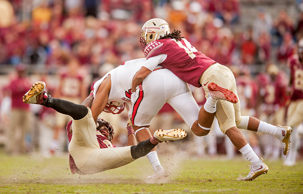 TALLAHASSEE, FL - NOVEMEBER 14: Terrance Smith #24 and Javien Elliott #14 of the Florida State Seminoles take down David J. Grinnage during the game at Doak Campbell Stadium on November 14, 2015 in Tallahassee, Florida. The Florida State Seminoles beat the North Carolina Wolfpack 34-17. (Photo by Jeff Gammons/Getty Images) *** Local Caption *** Terrance Smith; Javien Elliott; David J. Grinnage