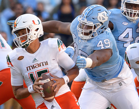 CHAPEL HILL, NC - NOVEMBER 14:  Jeremiah Clarke #49 of the North Carolina Tar Heels sacks Brad Kaaya #15 of the Miami Hurricanes during their game at Kenan Stadium on November 14, 2015 in Chapel Hill, North Carolina.  (Photo by Grant Halverson/Getty Images)