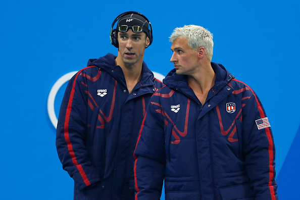 RIO DE JANEIRO, BRAZIL - AUGUST 09:  Michael Phelps and Ryan Lochte of the United States look on before the Men's 4 x 200m Freestyle Relay Final on Day 4 of the Rio 2016 Olympic Games at the Olympic Aquatics Stadium on August 9, 2016 in Rio de Janeiro, Brazil.  (Photo by Clive Rose/Getty Images)