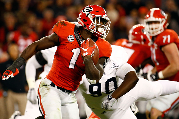 ATHENS, GA - NOVEMBER 21: Sony Michel #1 of the Georgia Bulldogs runs the ball past Darrius Sapp #90 of the Georgia Southern Eagles during the first half at Sanford Stadium on November 21, 2015 in Athens, Georgia. (Photo by Daniel Shirey/Getty Images)