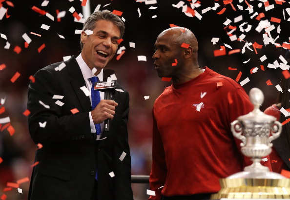 NEW ORLEANS, LA - JANUARY 02:  Head coach Charlie Strong of the Louisville Cardinals is interviewed by sportscaster Chris Fowler as he celebrates their 33 to 23 win over the Florida Gators in the Allstate Sugar Bowl at Mercedes-Benz Superdome on January 2, 2013 in New Orleans, Louisiana.  (Photo by Matthew Stockman/Getty Images)