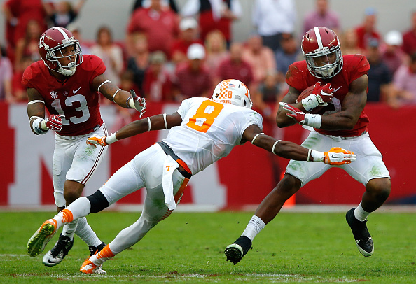TUSCALOOSA, AL - OCTOBER 24:  Derrick Henry #2 of the Alabama Crimson Tide rushes against Justin Martin #8 of the Tennessee Volunteers at Bryant-Denny Stadium on October 24, 2015 in Tuscaloosa, Alabama.  (Photo by Kevin C. Cox/Getty Images)