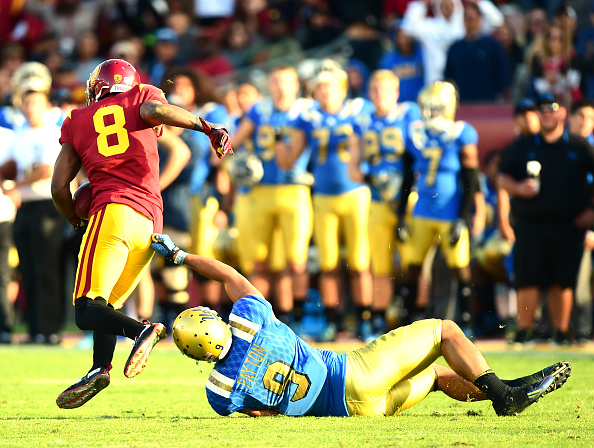 LOS ANGELES, CA - NOVEMBER 28:  Iman Marshall #8 of the USC Trojans makes an interception in front of a Jordan Payton #9 of the UCLA Bruins during a 40-21 Trojan win at Los Angeles Memorial Coliseum on November 28, 2015 in Los Angeles, California.  (Photo by Harry How/Getty Images)