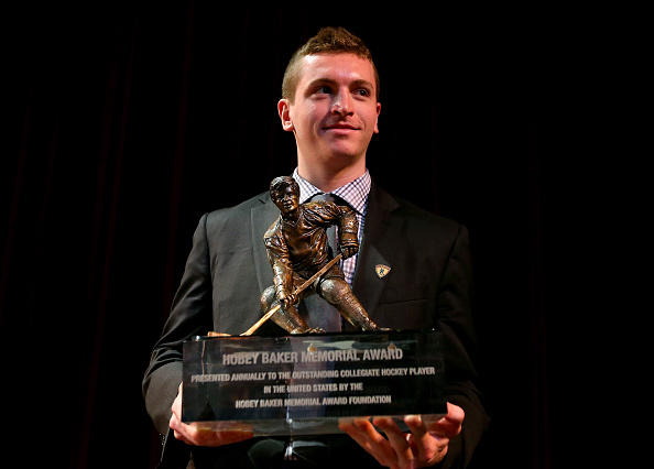 TAMPA, FLORIDA - APRIL 08: Jimmy Vesey of Harvard University and Hobey Baker Award winner poses with the trophy after the 2016 Hobey Baker Memorial Award ceremony at Tampa Theatre on April 8, 2016 in Tampa, Florida.The Hobey Baker Award is given to college hockey's best player. (Photo by Elsa/Getty Images)