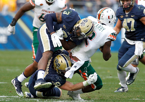 PITTSBURGH, PA - NOVEMBER 27:  Nicholas Grigsby #3 of the Pittsburgh Panthers hits Joseph Yearby #2 of the Miami Hurricanes in the second half during the game on November 27, 2015 at Heinz Field in Pittsburgh, Pennsylvania.  (Photo by Justin K. Aller/Getty Images)