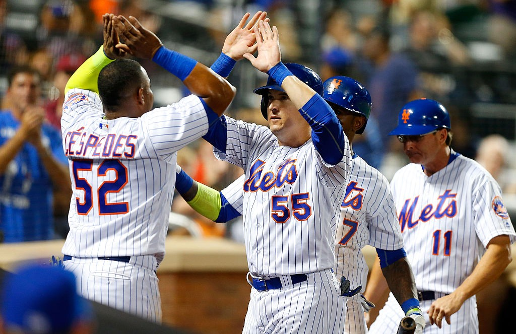 NEW YORK, NY - AUGUST 31: Kelly Johnson #55 of the New York Mets celebrates his three run double against the Miami Marlins after the eighth inning with teammate Yoenis Cespedes #52 at Citi Field on August 31, 2016 in the Flushing neighborhood of the Queens borough of New York City. (Photo by Jim McIsaac/Getty Images)
