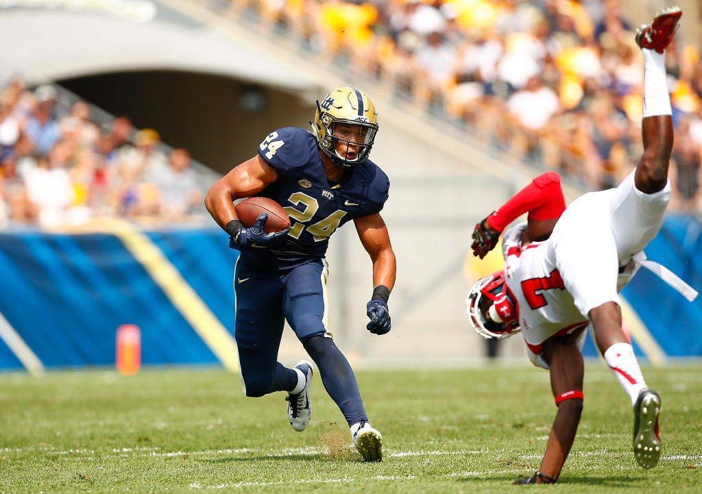 PITTSBURGH, PA - SEPTEMBER 05:  James Conner #24 of the Pittsburgh Panthers runs with the ball past an upended Kenneth Durden #7 of the Youngstown State Penguins in the first half during the game at Heinz Field on September 5, 2015 in Pittsburgh, Pennsylvania.  (Photo by Jared Wickerham/Getty Images)