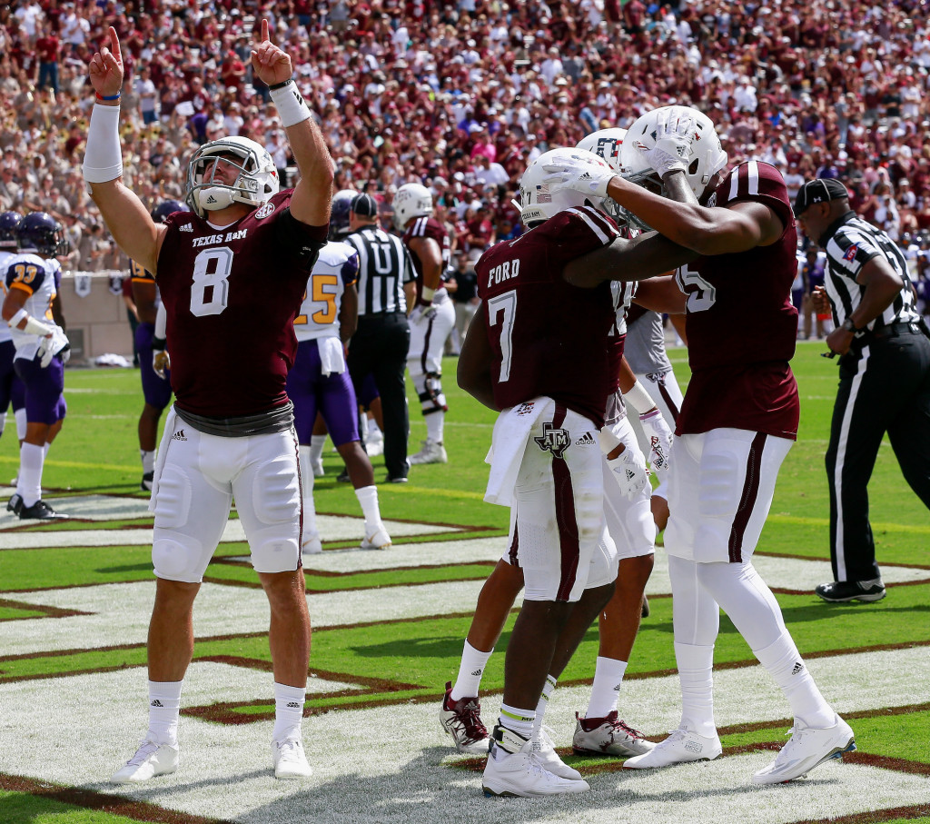 COLLEGE STATION, TX - SEPTEMBER 10:  Keith Ford #7 of the Texas A&M Aggies celenbrtates with teammates after a first quarter score against the Prairie View A&M Panthers at Kyle Field on September 10, 2016 in College Station, Texas.  (Photo by Bob Levey/Getty Images)