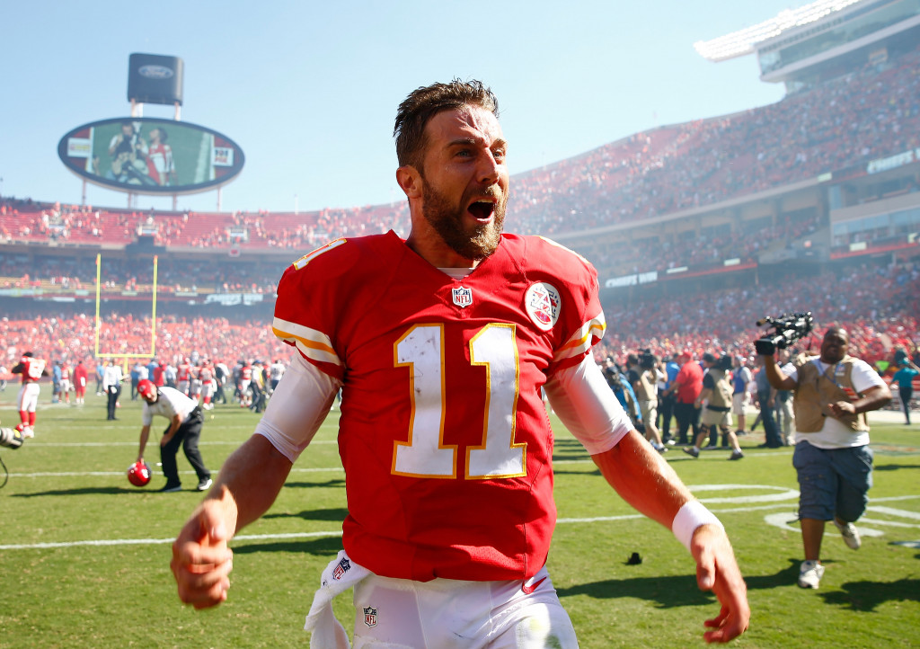 KANSAS CITY, MO - SEPTEMBER 11:  Quarterback Alex Smith #11 of the Kansas City Chiefs celebrates after scoring a touchdown as the Chiefs defeat the San Diego Chargers 33-27 to win the game in overtime at Arrowhead Stadium on September 11, 2016 in Kansas City, Missouri.  (Photo by Jamie Squire/Getty Images)