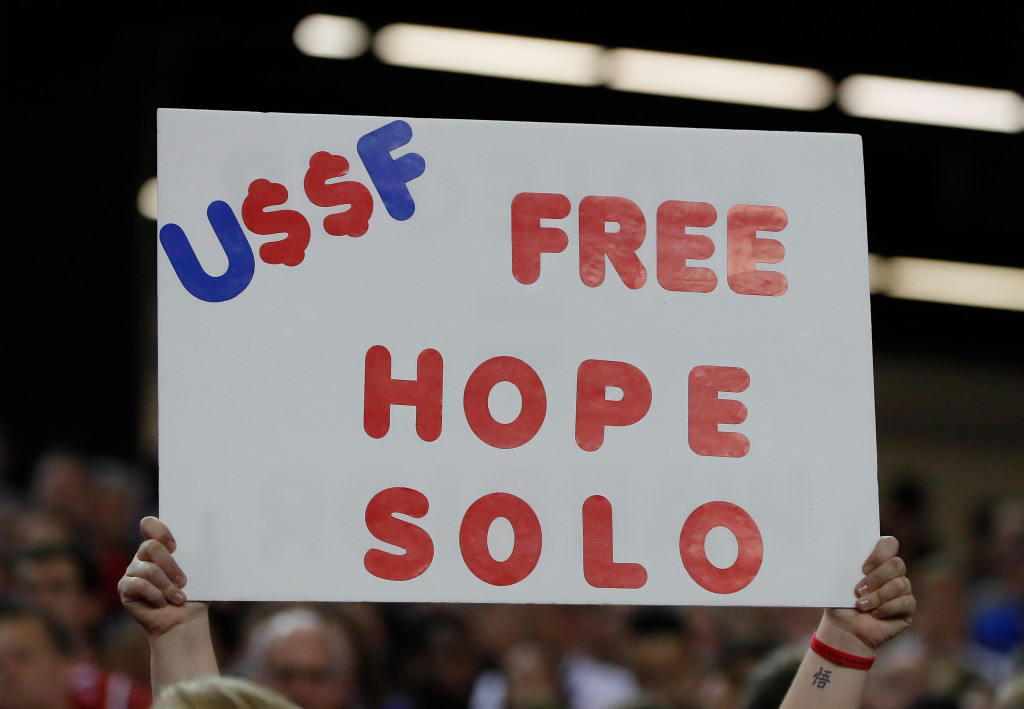 """ATLANTA, GA - SEPTEMBER 18:  A sign with the words """"Free Hope Solo"""" on it is seen prior to the match between the United States and the Netherlands at Georgia Dome on September 18, 2016 in Atlanta, Georgia.  (Photo by Kevin C. Cox/Getty Images)"""