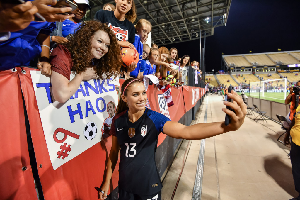 COLUMBUS, OH - SEPTEMBER 15:  Alex Morgan #13 of the US Women's National Team takes a selfie with fans after a game against Thailand on September 15, 2016 at MAPFRE Stadium in Columbus, Ohio. The United States defeated Thailand 9-0.  (Photo by Jamie Sabau/Getty Images)