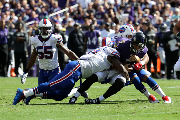 BALTIMORE, MD - SEPTEMBER 11: Quarterback Joe Flacco #5 of the Baltimore Ravens is sacked in the second half of the Buffalo Bills vs. the Baltimore Ravens game at M&T Bank Stadium on September 11, 2016 in Baltimore, Maryland. (Photo by Rob Carr/Getty Images)