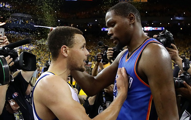 OAKLAND, CA - MAY 30: Stephen Curry #30 of the Golden State Warriors speaks with Kevin Durant #35 of the Oklahoma City Thunder after their 96-88 win in Game Seven of the Western Conference Finals during the 2016 NBA Playoffs at ORACLE Arena on May 30, 2016 in Oakland, California. (Photo by Ezra Shaw/Getty Images)