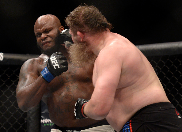 LAS VEGAS, NV - JULY 07: (R-L) Roy Nelson punches Derrick Lewis in their heavyweight bout during the UFC Fight Night event inside the MGM Grand Garden Arena on July 7, 2016 in Las Vegas, Nevada. (Photo by Brandon Magnus/Zuffa LLC/Zuffa LLC via Getty Images)